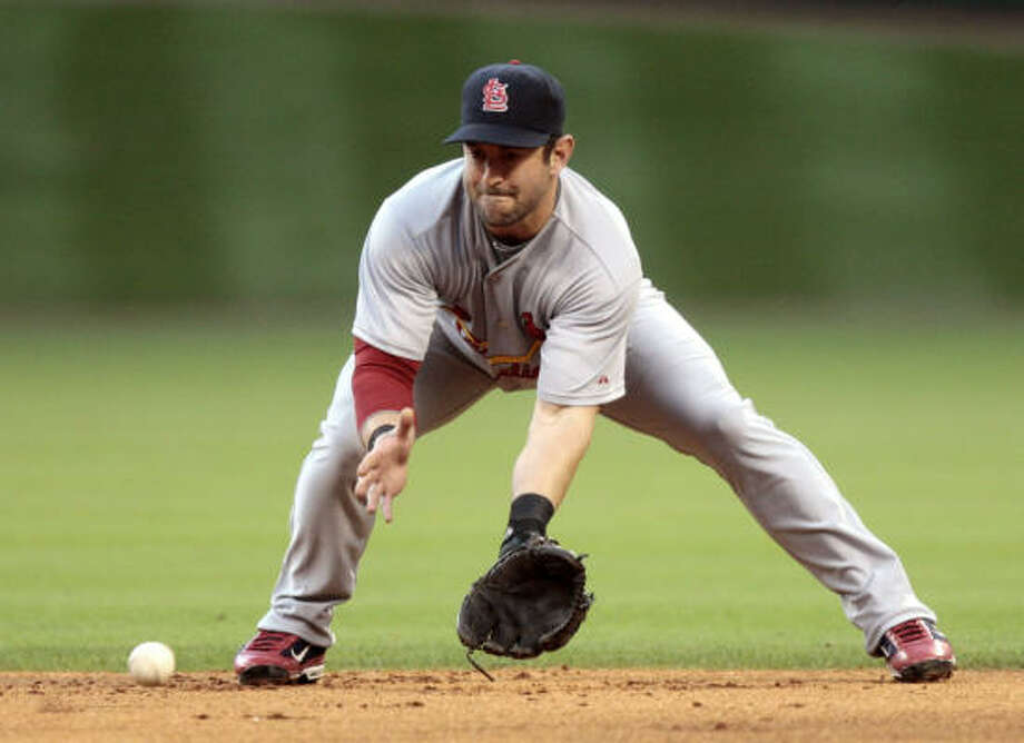 Cardinals second baseman Nick Punto fields a ground ball. Photo: Bob Levey, Getty Images