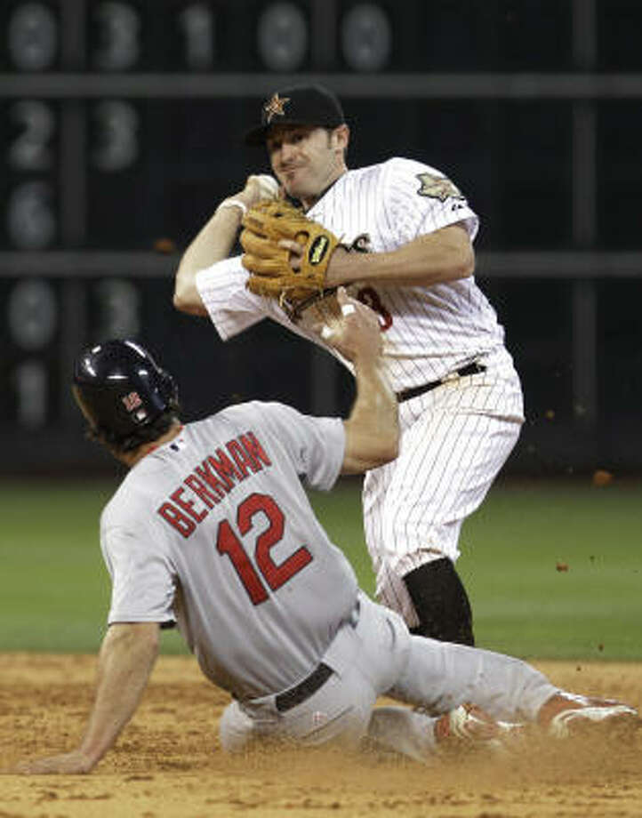 Cardinals' Lance Berkman (12) is out at second base as Astros second baseman Joe Inglett (3) throws to first base to complete the double play on Yadier Molina in the sixth inning. Photo: Pat Sullivan, AP