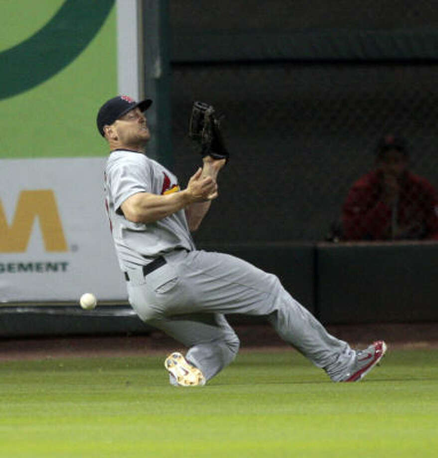 Cardinals left fielder Matt Holliday loses the ball in the lights on a double by Joe Inglett. Photo: Bob Levey, Getty Images