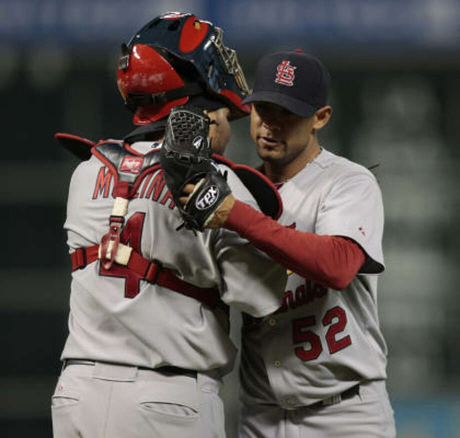 Cardinals pitcher Eduardo Sanchez hugs catcher Yadier Molina after getting the final out of the game. Photo: Bob Levey, Getty Images