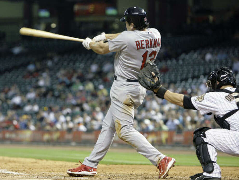 St. Louis' Lance Berkman follows through on a double to left field that gave the Cardinals a 5-4 lead in the top of the ninth. Berkman, a former Astro, went 2-for-5 with an RBI in his first game back in Houston. Photo: Cody Duty, Chronicle