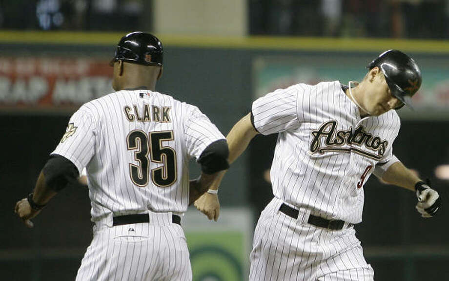 Hunter Pence, right, is greeted by third base coach Dave Clark after hitting a home run in the fourth inning. Photo: Cody Duty, Chronicle