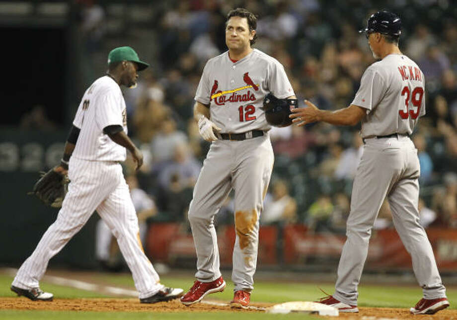 Cardinals first baseman Lance Berkman, center, looks on in disappointment after not beating a throw to first base. Photo: Cody Duty, Chronicle