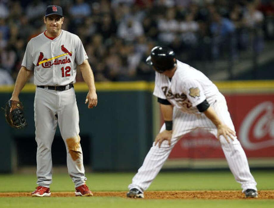 St. Louis' Lance Berkman, left, jokes with Astros third baseman Chris Johnson. Photo: Cody Duty, Chronicle