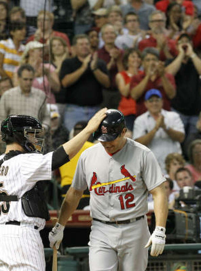 Cardinals first baseman Lance Berkman receives a pat on the helmet from Astros catcher Humberto Quintero and a standing ovation as he walks to the plate in the second inning. Photo: Cody Duty, Chronicle