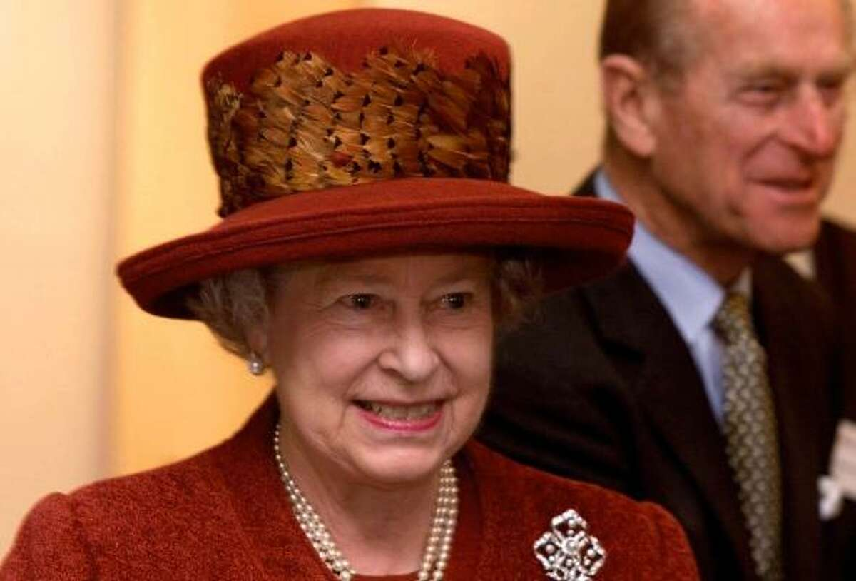 Britain's Queen Elizabeth II wears a hat adorned with pheasant feathers.