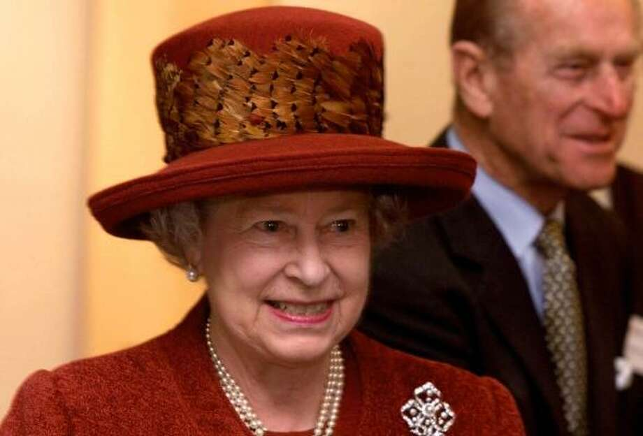 Britain's Queen Elizabeth II wears a hat adorned with pheasant feathers. Photo: FINDLAY KEMBER, AP