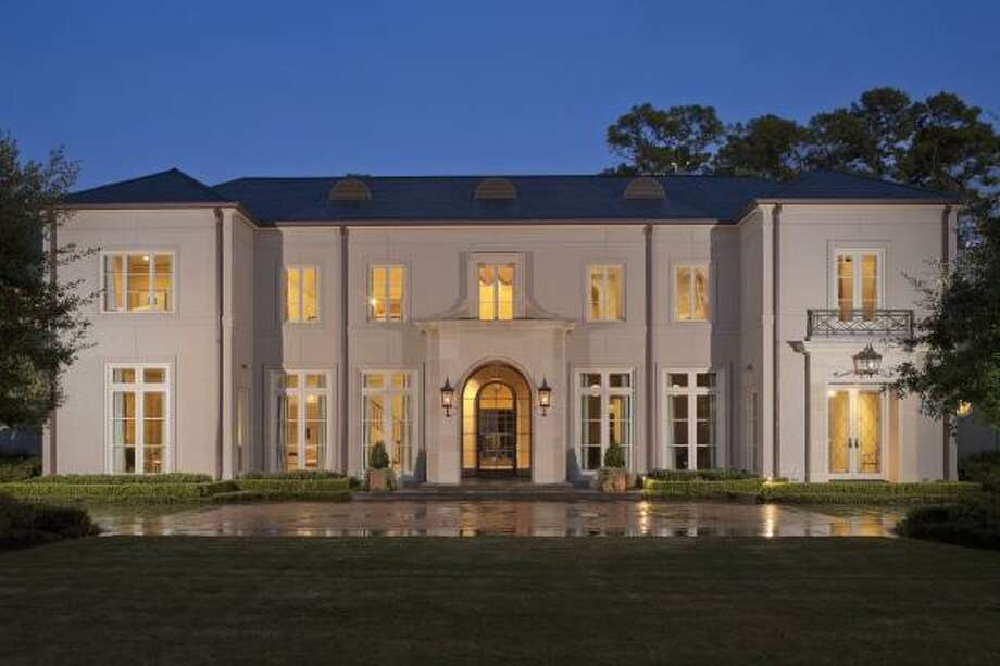 A large driveway leads to the front of the home.Rudy Colby of Colby Design designed this neoclassical-style home in Piney Point. It was built by Andy Abercrombie of Abercrombie Builders in 2006.