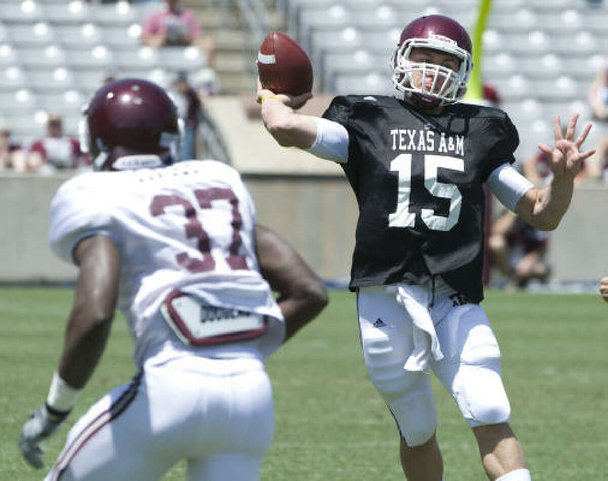 Freshman quarterback Johnny Manzeil looks to throw the ball down the field.