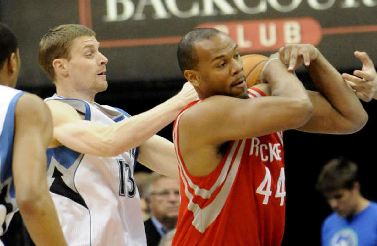 Timberwolves' Luke Ridnour, left, causes Rockets center Chuck Hayes to lose the ball.