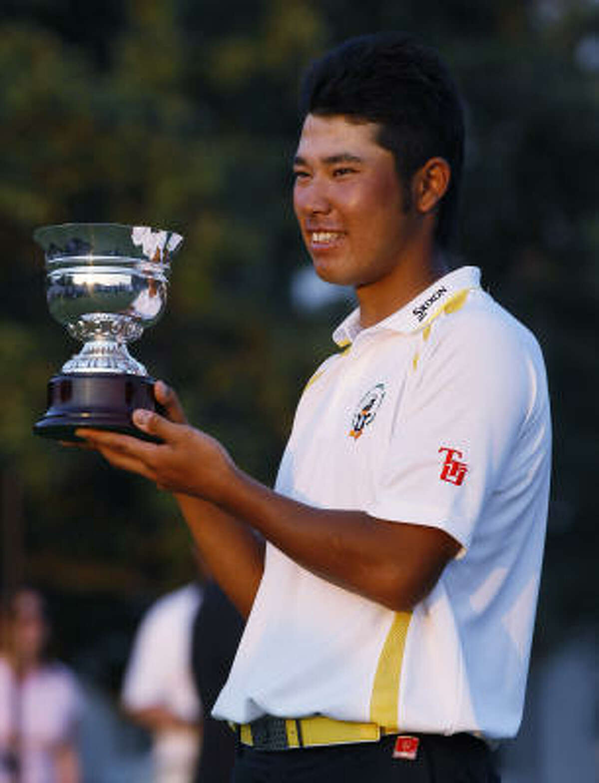 Hideki Matsuyama of Japan holds his amateur championship trophy.