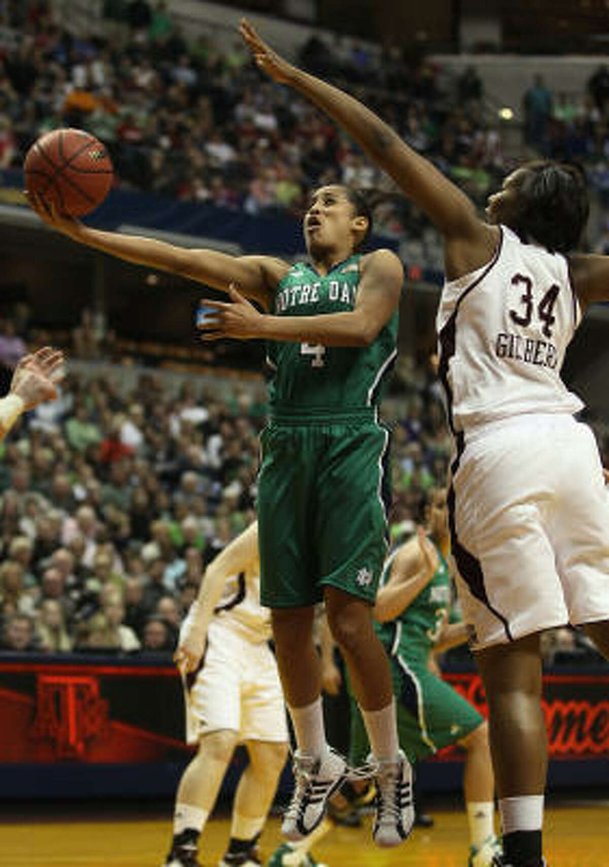 Skylar Diggins of the Notre Dame Fighting Irish takes a shot as Karla Gilbert of the Texas A&M Aggies defends.
