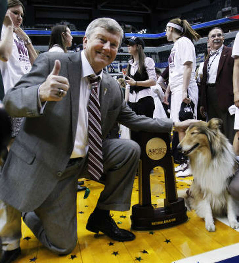 Texas A&M head coach Gary Blair celebrates with team mascot Reveille VIII after their team's 76-70 win over Notre Dame. Photo: Michael Conroy, AP