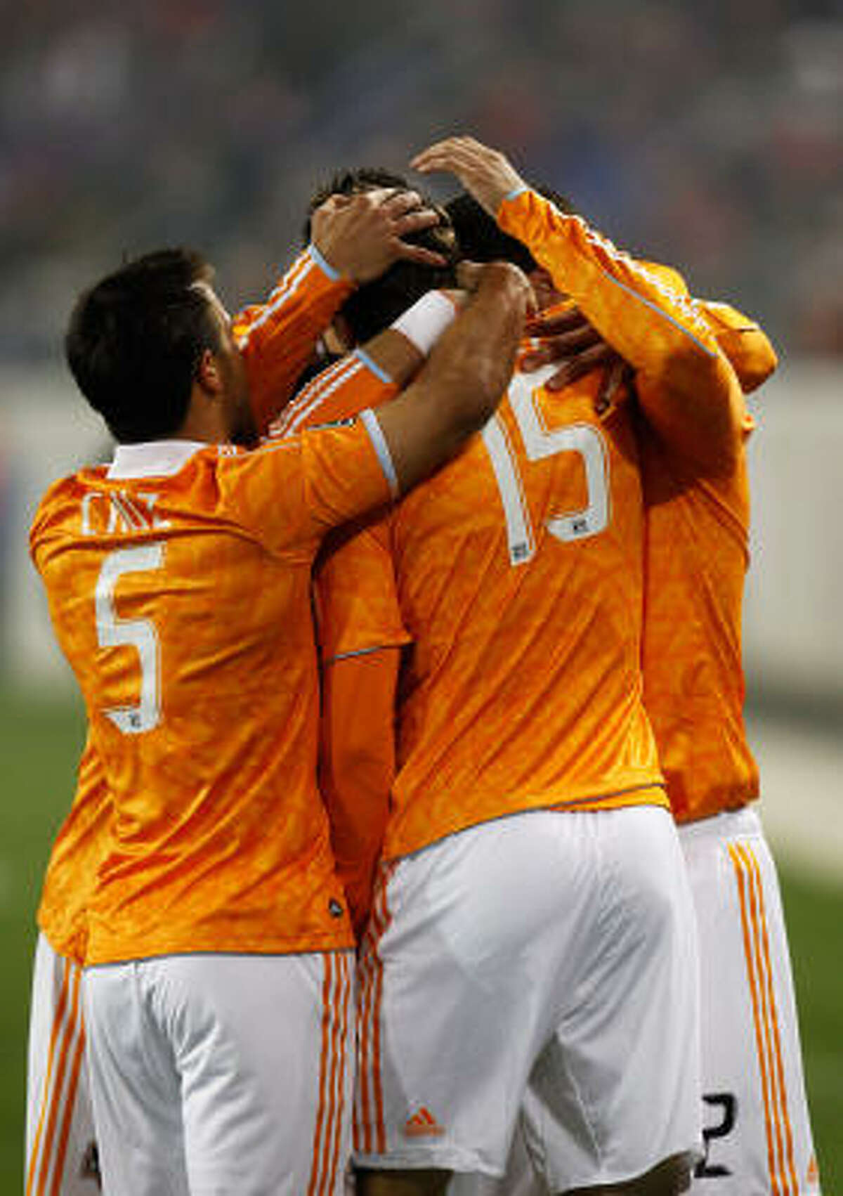 Dynamo forward Cameron Weaver is surrounded by teammates as they celebrate his game-tying goal in the second half against the New York Red Bulls.