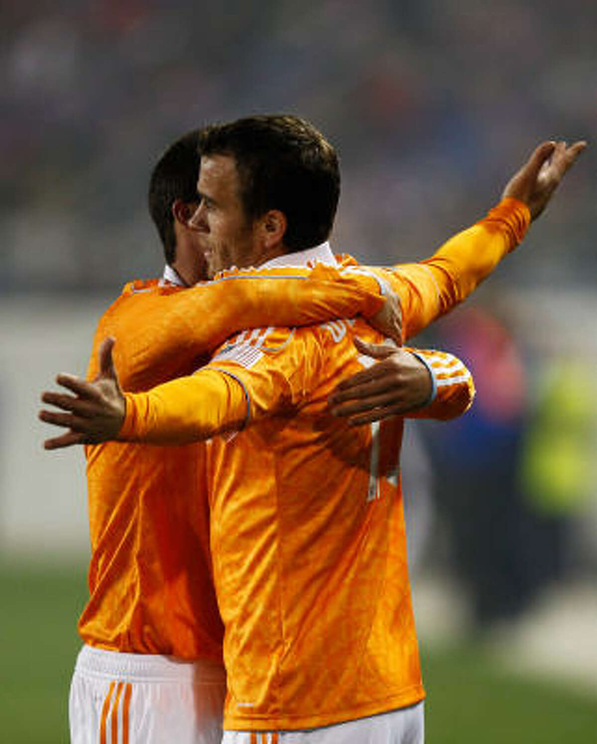 Dynamo forward Cameron Weaver, right, celebrates his game-tying goal in the second half against the New York Red Bulls.