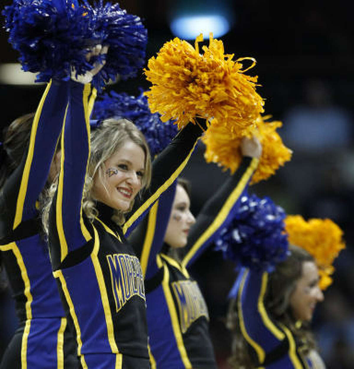 Morehead State cheerleaders perform during a timeout.