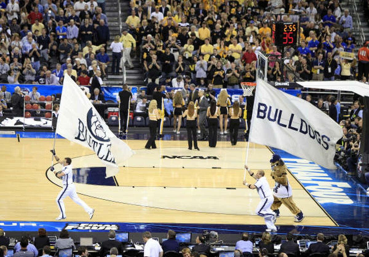 The Butler Bulldog cheerleaders run onto the court before the first half of the NCAA National Semifinals on Saturday.