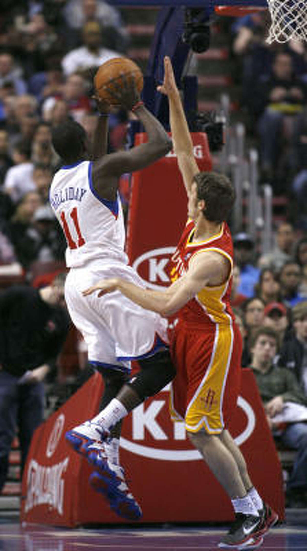 Rockets' Goran Dragic, right, defends as 76ers' Jrue Holiday(11) goes up for a score.