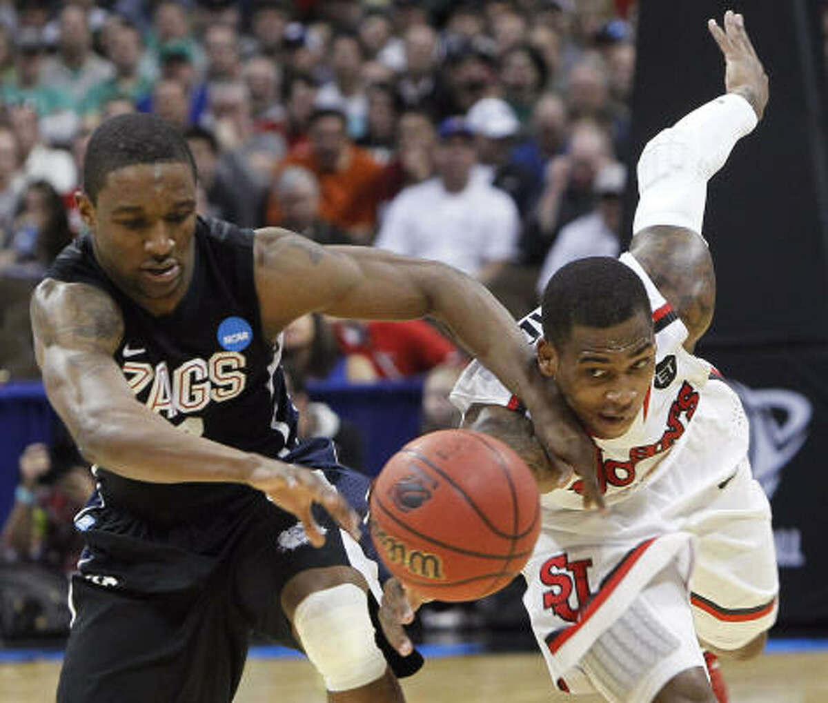St. John's guard Dwight Hardy, right, strips the ball from Gonzaga guard Demetri Goodson in the second half.
