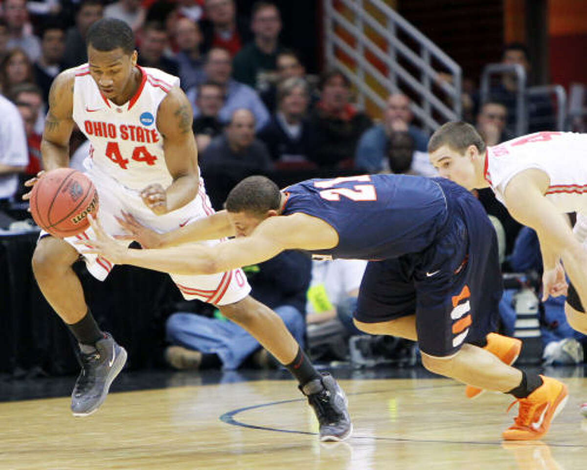 Ohio State's William Buford (44) steals the ball from UTSA guard Devin Gibson in the first half.