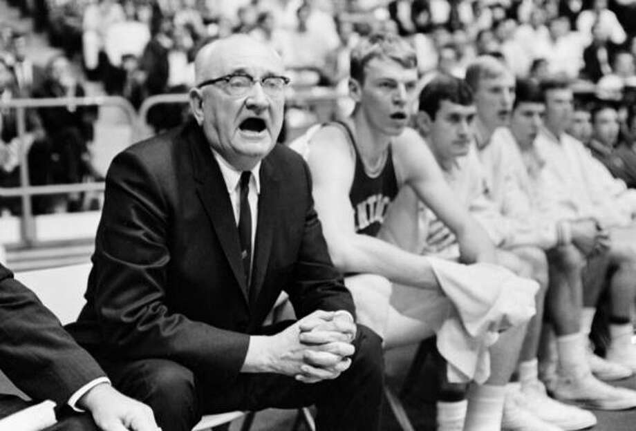 The past, Part II   Legendary Kentucky coach Adolph Rupp finished his career with 876 wins, then the most all-time, and four national titles. He has since been past, but he's still fourth all-time. Rupp learned the game from Dr. James Naismith, the inventor of basketball, at the University of Kansas, then made Kentucky into one of sports' most venerated franchises. Kentucky's basketball facility is called Rupp Arena. It holds 23,500 fans, and Kentucky annually leads the national in home attendance. Photo: AP
