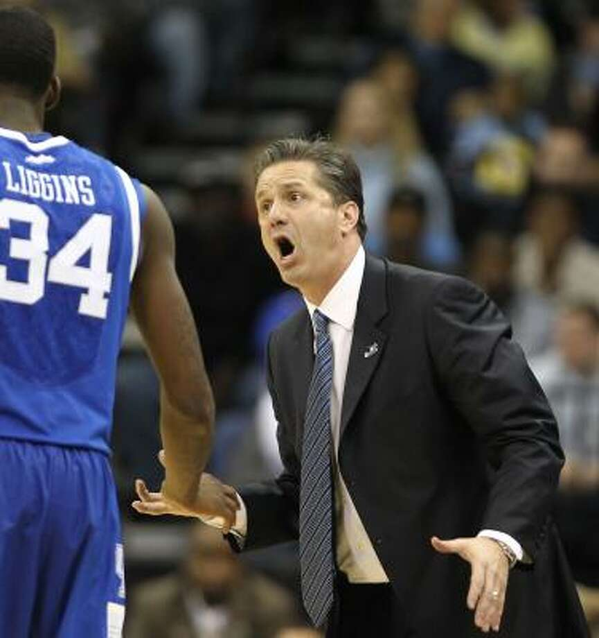 John CalipariCalipari — known widely as Coach Cal — joined former Kentucky coach Rick Pitino as the only coach to lead three different programs to the Final Four. Calipari's previous visits at Massachusetts (1996) and Memphis (2008) were vacated by the NCAA for rules violations. Calipari was not found liable in either instance. Calipari led Memphis to the 2009 national championship game, where it lost to Kansas. The next season, he moved on to Kentucky. Photo: Nick De La Torre, Chronicle