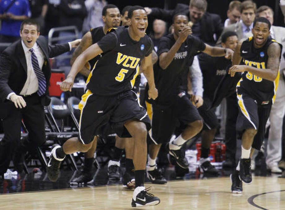 "To playing in the Final Four   Realistically, the only people who thought VCU had a shot to beat Kansas were on the VCU bench. Kansas was that much of a favorite entering the game. Many figured a blowout, a huge margin. And that's just what we got in the first half, but with VCU on top. Brandon Rozzell's 3-pointer gave VCU a 39-21 lead, its biggest of the game, with 3:52 left in the first half. Kansas stormed back getting within 46-44 on a Tyshawn Taylor free throw with 13:13 to play, but the Jayhawks never retook the lead. Jamie Skeen made a 3-pointer to cap a 9-2 run that extended the VCU lead to 55-46 with 10 minutes left. The Rams held on for history. ""Once again, we felt like nobody really thought we could win going into the game,"" VCU coach Shaka Smart said. ""But these guys believed we could win. They knew we could win. And we talked before the game about how nobody else really matters, what they think. And that's our theme throughout the NCAA tournament since we were selected. And our guys have done a phenomenal job of putting all the doubters aside, putting all the people that didn't believe in us aside and going out and doing their job. Today, they did their job to the tune of a 10-point victory over, I think, the team that was on paper, the best team left in the NCAA tournament."" Photo: Rich Sugg, MCT"