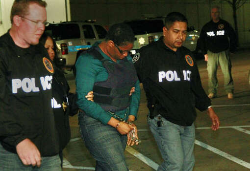 Jessica Tata is escorted by U.S. Marshall to the Harris County Jail on Tuesday, March 22, 2011, in Houston. Photo: Mayra Beltran, Houston Chronicle