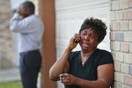 Missy Tata, the mother of Jessica Tata, 22, operator of the day care facility called Jackie's Child Care, talks on the phone after a fire broke out at her daughter's day care center. Photo: Michael Paulsen, Houston Chronicle