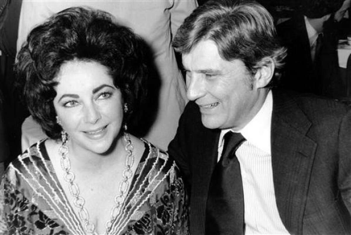 This Jan. 30, 1977 file photo shows actress Elizabeth Taylor and her husband, former secretary of the U.S. Navy John Warner, at the 42nd New York Film Critics Circle Awards dinner in New York.