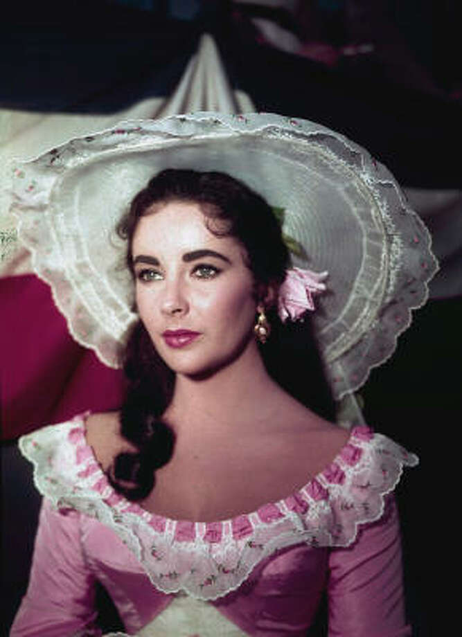 "In this 1957 file photo, actress Elizabeth Taylor is shown in costume for her character in the film ""Raintree County."" Photo: AP"