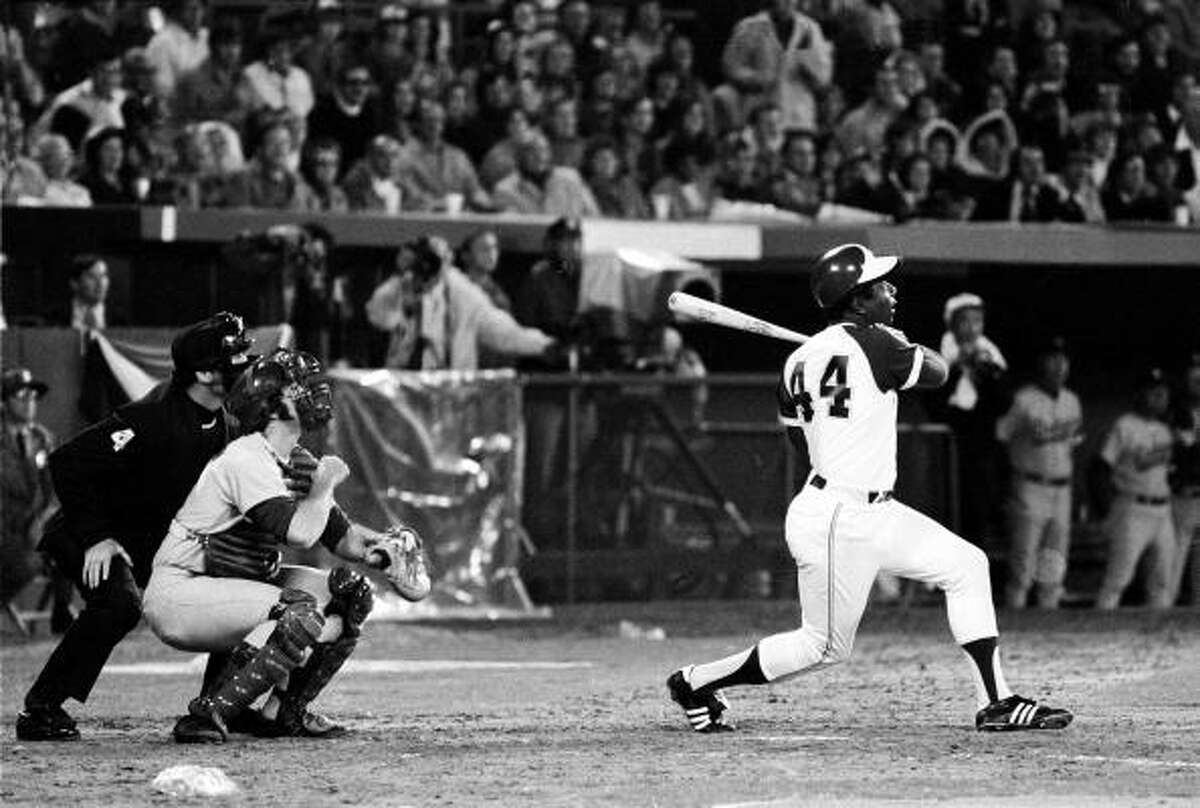 Atlanta Braves - Hank Aaron To many, he's still the real Home Run King. On top of the 755 home runs, Aaron is first in runs batted in 2,292), third in hits (3,771) and won two batting titles, three Gold Gloves and one Most Valuable Player Award. In all, Aaron finished in the top five of the MVP voting eight times and the top 10 13 times. First runner-up: Greg Maddux.