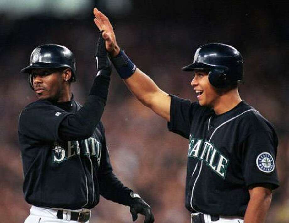 Seattle Mariners– Alex Rodriguez Ken Griffey Jr. (left), no doubt, is Mr. Mariner. And he was truly something to behold (630 home runs, 1,886 RBI, 10 Gold Gloves, one MVP). As as great as Griffey was, ARod has been even better (613 home runs and 1,831 RBI, three MVPs and still going). Griffey's average stat line over his best 10 years: .302, 38 homers, 109 RBI, 100 runs scored. ARod's average stat line over his best 10 years: .303, 45, 125, 122. And that 10-year run doesn't even include him batting .358 and finishing second in the MVP voting when he turned 21. If ARod had stayed at shortstop, he could have usurped Honus Wagner as the greatest ever to play the position. Photo: Otto Greule Jr, Getty Images