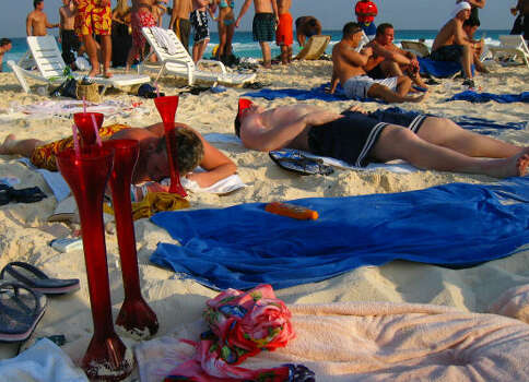 Students on spring break got in lots of sunbathing in Cancun, Mexico in 2003. Photo: JOSE LUIS MAGANA, ASSOCIATED PRESS