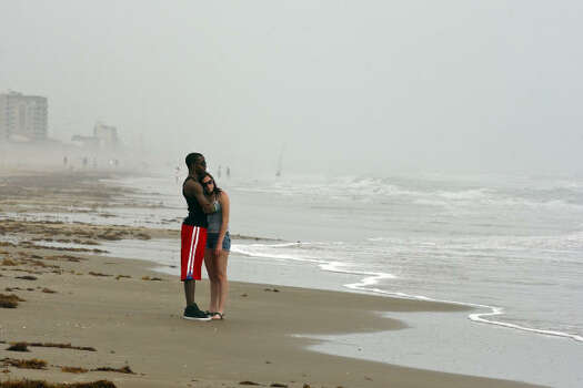 Derrick Haygood, 19, left, and Lauren Morgenstern, 17, both from Dallas, enjoy a morning walk while on spring break Monday March 14, 2011 on South Padre Island, Tx. Photo: EDWARD A. ORNELAS, SAN ANTONIO EXPRESS-NEWS