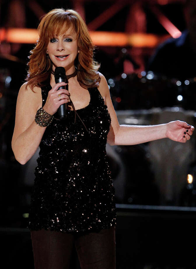 "Reba McEntire performs at the Brooks & Dunn ""The Last Rodeo"" tribute concert on Monday, April 19, 2010, in Las Vegas.  (AP Photo/Matt Sayles) Photo: Matt Sayles, Hearst / AP"