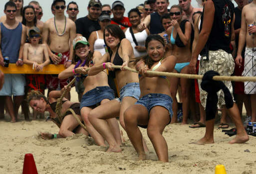 University of Texas students Jackie Lapid (front to rear), Ragan Meeks, Nicoloe Johns, and Angie Helvey take part in a tug of war game on South Padre Island on March 15, 2007 during Spring Break. The girls beat their opponents fron Texas State University. Photo: JOHN DAVENPORT, SAN ANTONIO EXPRESS-NEWS