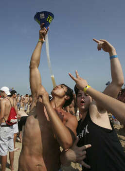 University of Texas at San Antonio students, Justin Benavidez, left, 21, uses a funnel, known as a beer bong, to drink beer with his friend Jose Salazar, right, 21, during Spring Break at the Coca-Cola Beach at the Radisson hotel on South Padre Island, Texas on March 11, 2009. Photo: Delcia Lopez, AP