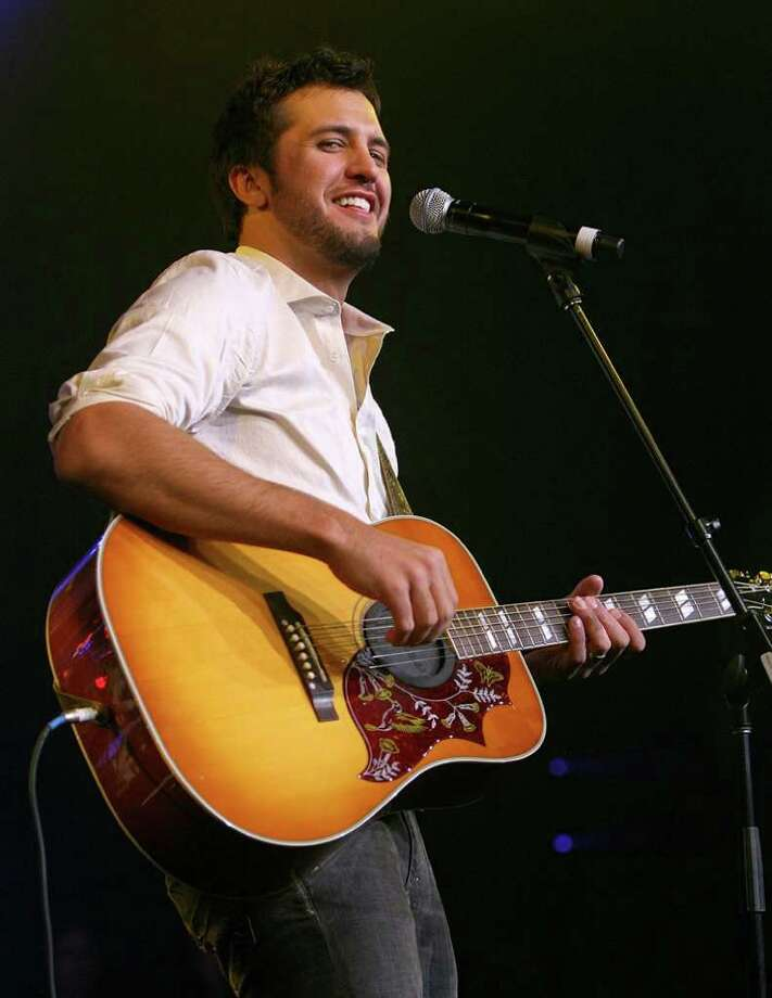 "Luke Bryan, Friday, 7:30 p.m. Bryan, out of Leesburg, Ga., made his rodeo debut in '09. His mixture of rousing dance hall country, charisma and songs from his debut CD, ""I'll Stay Me,"" fired up the crowd then. He's coming back with star power and a country/crossover third album, ""Tailgates & Tanlines,"" proving the rodeo talent buyers and audiences know how to pick 'em. Listen for the crowd to sing along with ""All My Friends Say,"" ""Do I"" and ""Country Girl (Shake It For Me). ETHAN MILLER / GETTY IMAGES Photo: Ethan Miller, Hearst / 2008 Getty Images"
