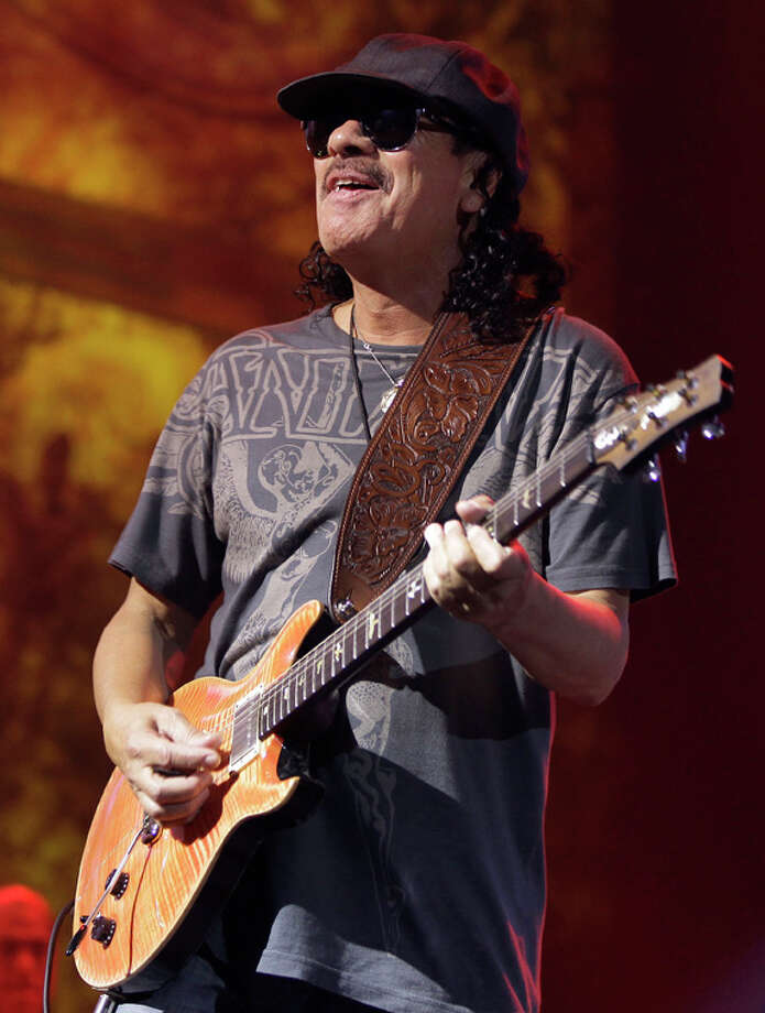 In this Aug. 25, 2010 file photo, musician Carlos Santana performs on stage at The Joint at the Hard Rock Hotel and Casino in Las Vegas. (AP Photo/Julie Jacobson, File) Photo: File Photo, Associated Press / AP2010