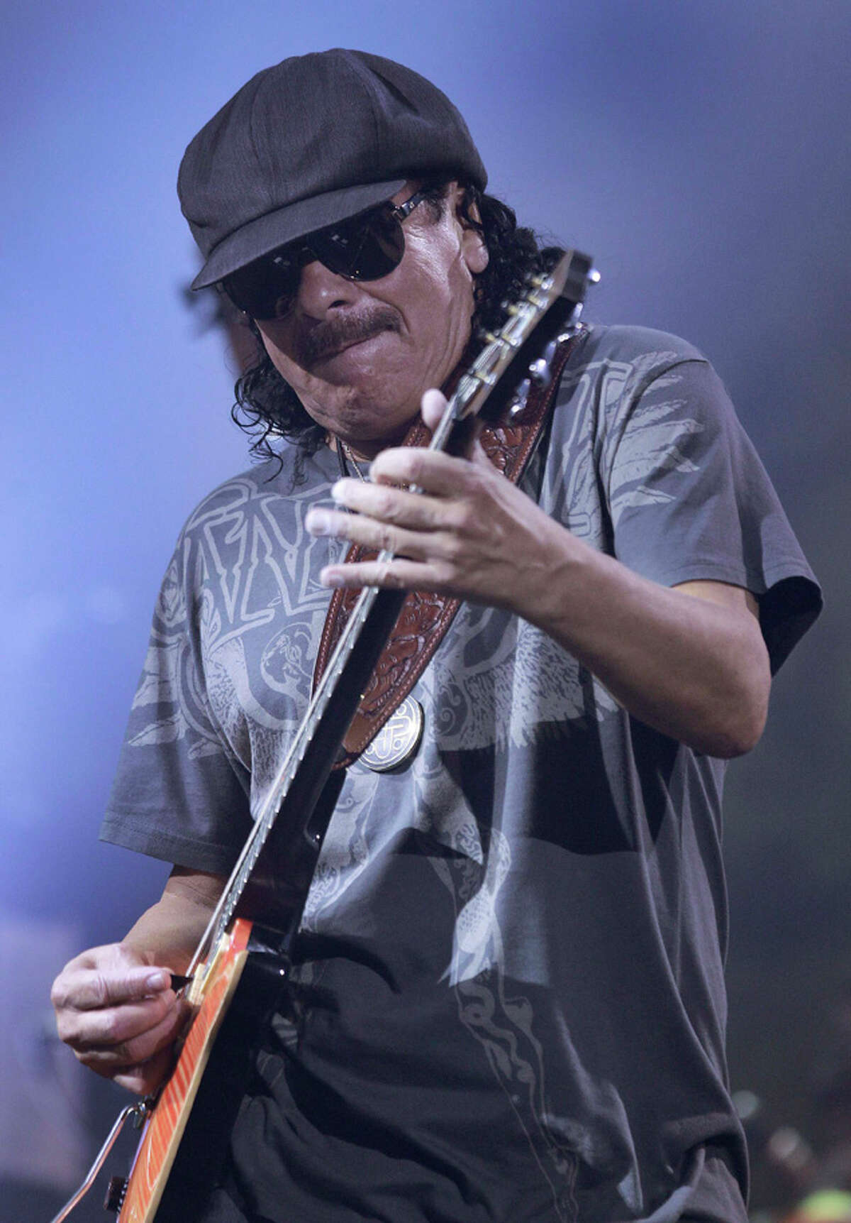 In this Aug. 25, 2010 file photo, Carlos Santana performs on stage at The Joint at the Hard Rock Hotel and Casino in Las Vegas.(AP Photo/Julie Jacobson)