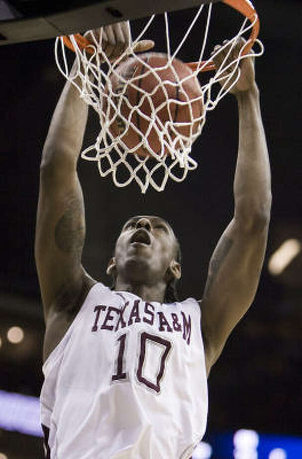 A&M's David Loubeau slams home two of his 20 points. Photo: Shane Keyser, MCT