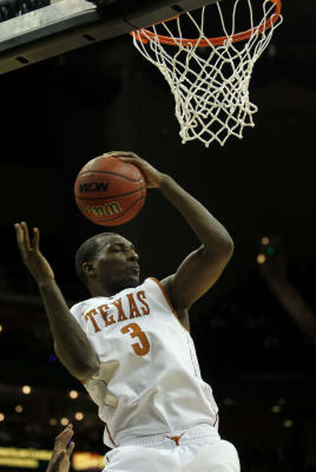 Texas' Jordan Hamilton grabs a rebound. Photo: Jamie Squire, Getty Images