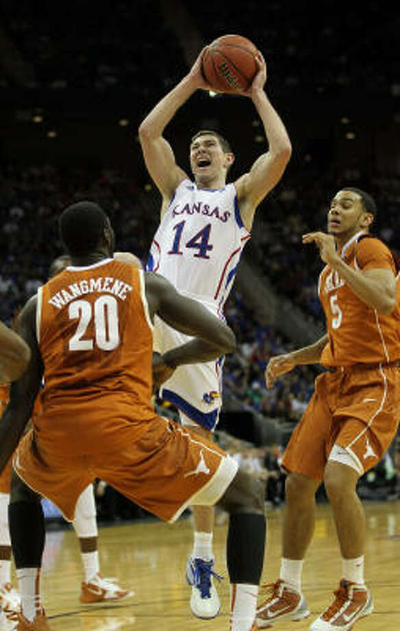 Kansas' Tyrel Reed goes up for a shot against the Texas Longhorns. Photo: Jamie Squire, Getty Images