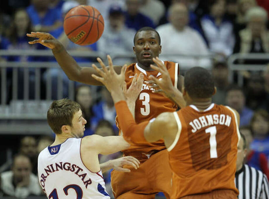 Texas' Jordan Hamilton passes the ball to Gary Johnson. Photo: Jamie Squire, Getty Images
