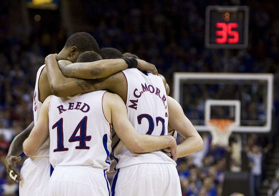 Kansas huddles on the court as they wait for Texas to come out of a time-out near the end of the Big 12 Championship game. Photo: Shane Keyser, MCT