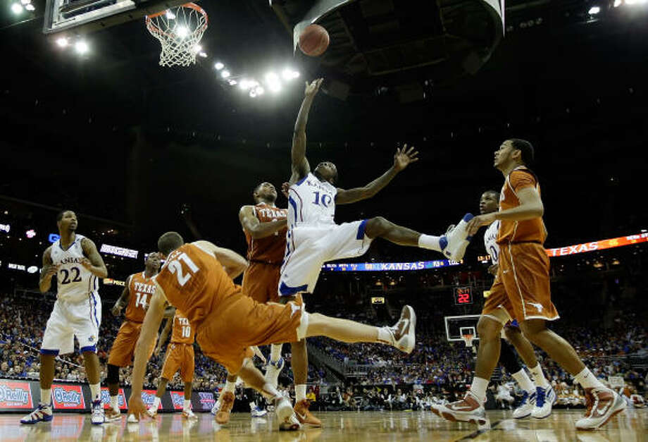 Kansas' Tyshawn Taylor throws up a shot against the Texas Longhorns. Photo: Jamie Squire, Getty Images