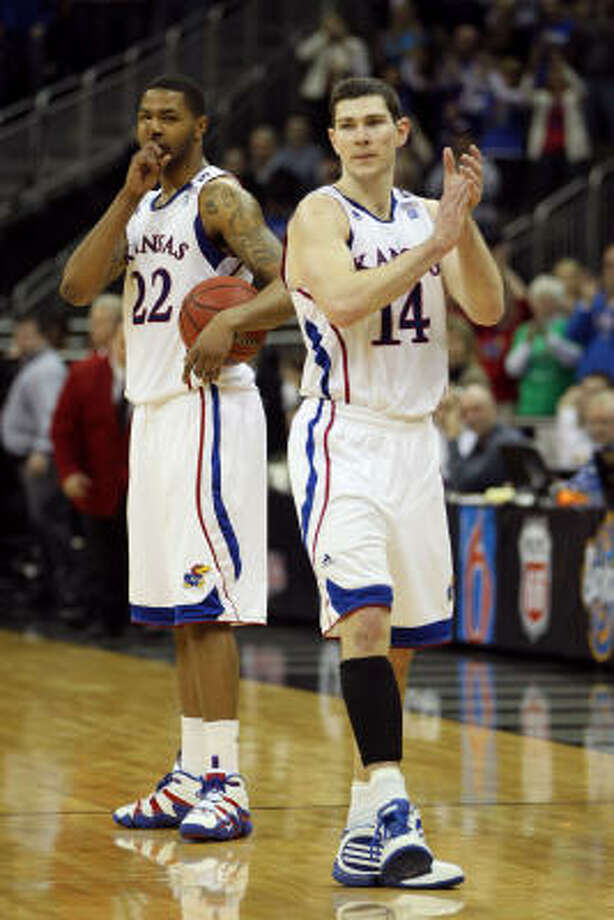 Kansas' Marcus Morris (22) and Tyrel Reed (14) of the Kansas Jayhawks celebrate in the final moments of their win over Texas. Photo: Jamie Squire, Getty Images