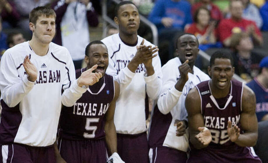 The Texas A&M bench applauds their team's effort in the second half. Photo: Rich Sugg, MCT