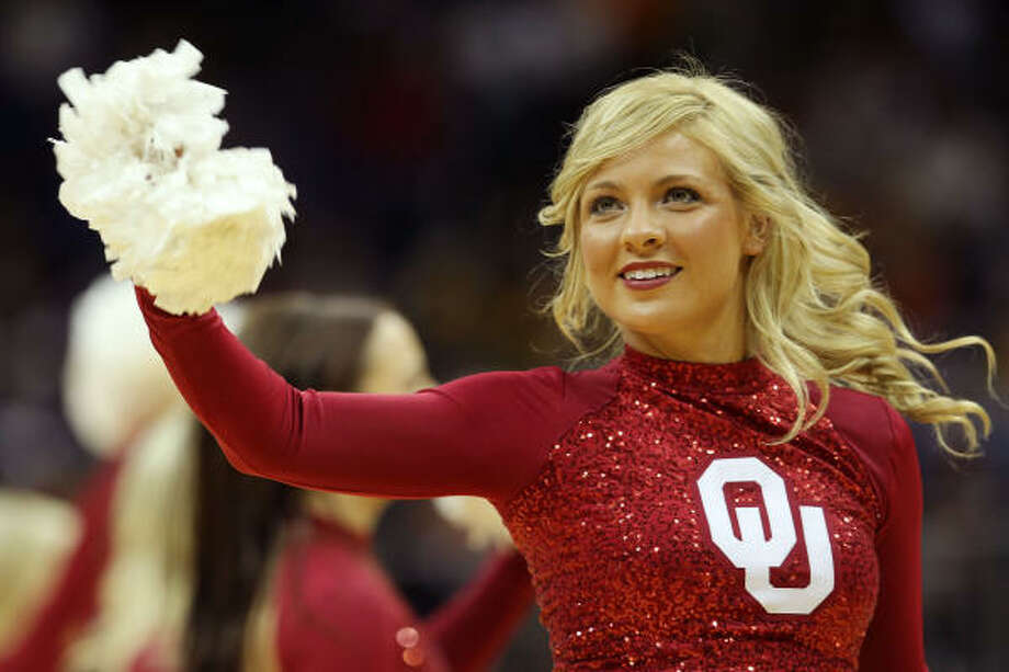 A cheerleader for the Oklahoma Sooners performs during their game against the Baylor Bears. Photo: Jamie Squire, Getty Images